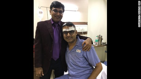 Neurosurgeon Dr. Sharan Srinivasan visits with Abhishek Prasad after the guitar player's brain surgery.
