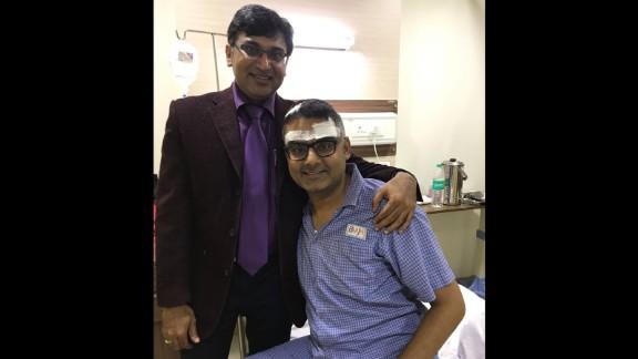 Neurosurgeon Dr. Sharan Srinivasan visits with Abhishek Prasad after the guitar player