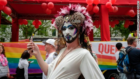 A Sister of Perpetual Indulgence strikes a pose during the annual gay pride parade in Berlin.