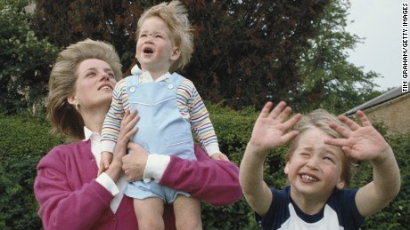 Princes William and Harry with their mother, Diana, Princess of Wales (1961 - 1997) in the garden of Highgrove House in Gloucestershire, 18th July 1986. William is wearing a Dallas Cowboys t-shirt.(Photo by Tim Graham/Getty Images)