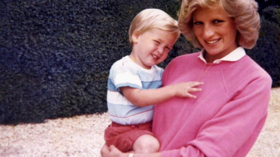 Diana, Princess of Wales, holding Prince William while pregnant with Prince Harry.