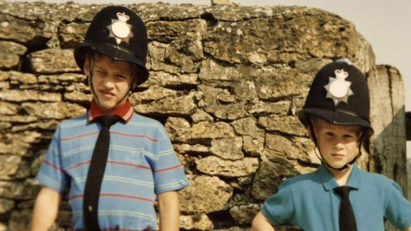 Princes William and Harry dress in UK police uniforms.