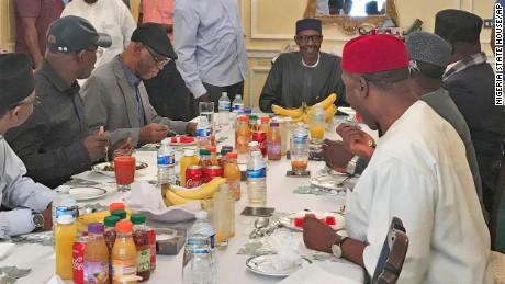 Nigeria's President Muhammadu Buhari is seen having lunch with senior members of the country's ruling party All Progressives Congress (APC) in Abuja house, London.