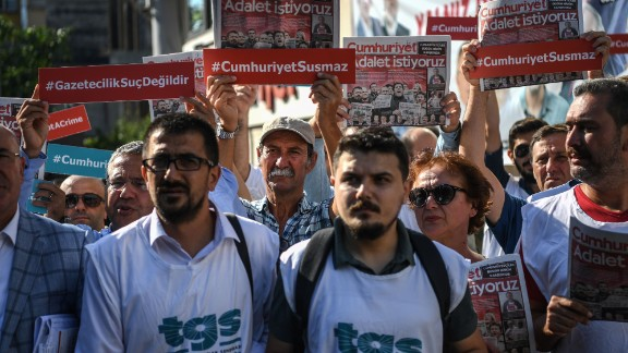 Reporters demonstrating as the trial of journalists from one of Turkey's opposition publications began Monday