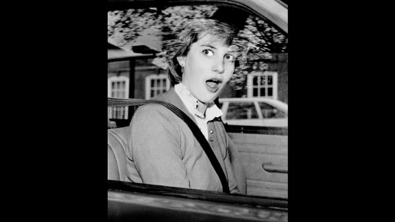 Diana looks startled after stalling her new car outside her London apartment in November 1980.