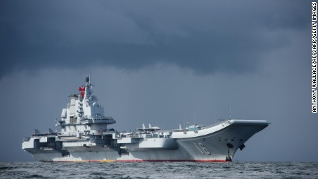 China's sole aircraft carrier, the Liaoning, arrives in Hong Kong waters on July 7, 2017, less than a week after a high-profile visit by Chinese President Xi Jinping. China's sole operational aircraft carrier arrived in Hong Kong for the first time in a display of military might less than a week after a high-profile visit by president Xi Jinping. / AFP PHOTO / ANTHONY WALLACE        (Photo credit should read ANTHONY WALLACE/AFP/Getty Images)