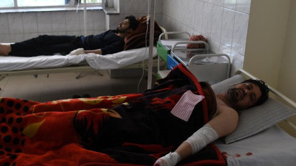 Afghan men rest in hospital after being injured in the attack.
