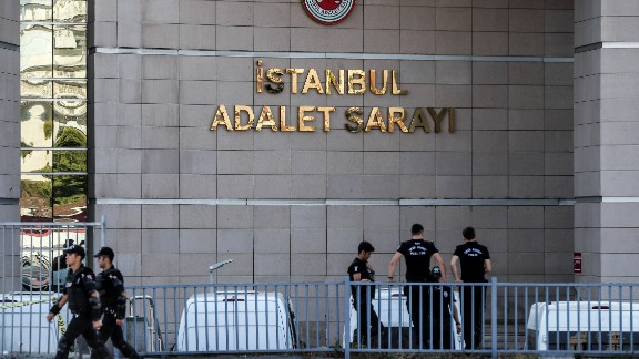 Turkish police stand guard outside the courthouse during the trial