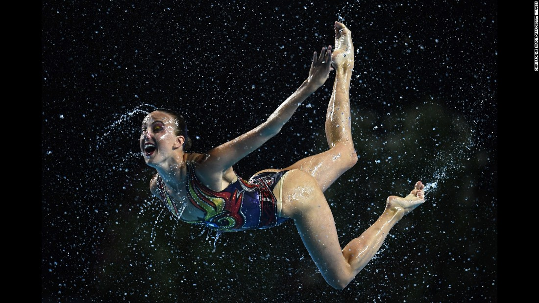 Russia compete in the women's team free routine during the synchronized swimming competition.