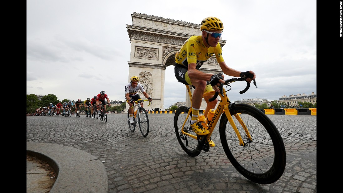 "Chris Froome leads a pack of cyclists past Paris' Arc de Triomphe on his way to <a href=""http://www.cnn.com/2017/07/23/sport/froome-wins-tour-de-france/index.html"" target=""_blank"">winning the Tour de France</a> on Sunday, July 23. It was Froome's fourth Tour de France title and his third in a row."