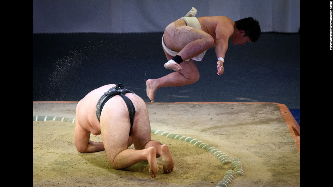 Japan's Hayato Miwa jumps over Ukraine's Oleksandr Veresiuk during a World Games sumo match on Sunday, July 23. Miwa won the match and eventually took bronze in the open-weight finals.