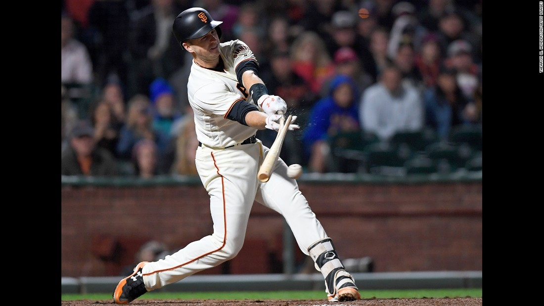 San Francisco star Buster Posey breaks his bat while hitting an RBI single against Cleveland on Thursday, July 18.