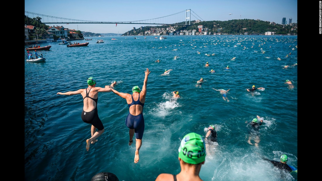 Competitors jump in the Bosphorus strait as they take part in the Bosphorus Cross Continental Swim on Sunday, July 23. The swimmers start from the Asian side of Istanbul and race 6.5 kilometers (4 miles) to the European side.