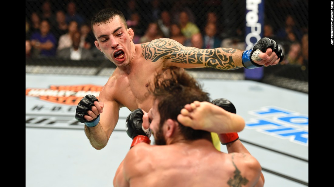UFC fighter Thomas Almeida kicks Jimmie Rivera during their bantamweight fight in Uniondale, New York, on Saturday, July 22. Rivera won by unanimous decision and remains undefeated in the UFC.