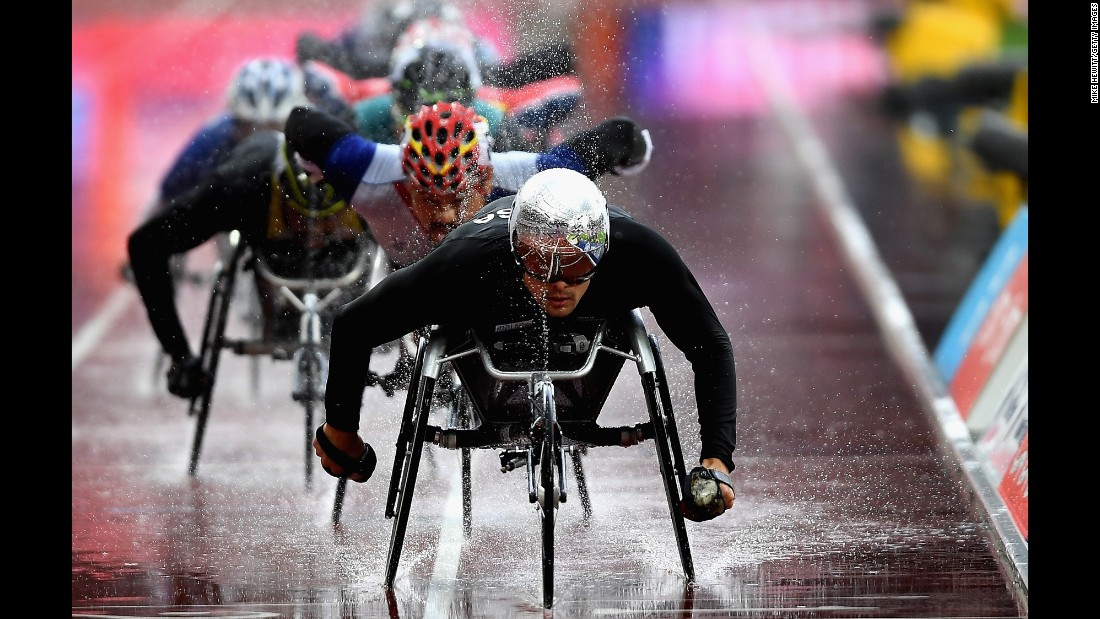 Swiss Paralympian Marcel Hug leads a pack of racers at the World Para Athletics Championships on Sunday, July 23. He won the T54 5,000 meters.