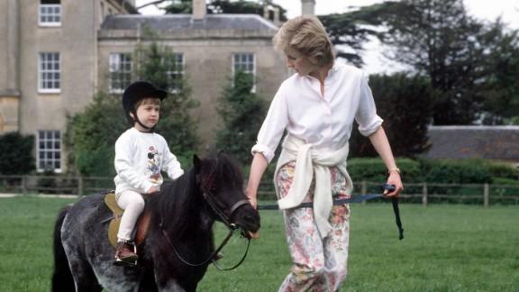William rides a miniature pony at Highgrove House.