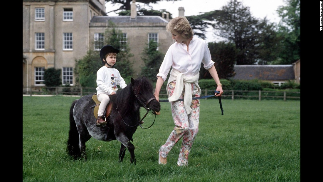 William rides a miniature pony at Highgrove House.