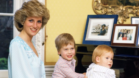 Diana watches her boys play at the piano in Kensington Palace in October 1985.