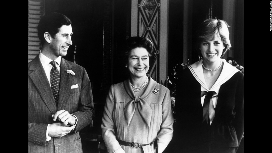 The couple poses with Charles' mother, Queen Elizabeth II, in March 1981.