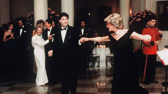 """Diana dances with actor John Travolta at the White House in November 1985. Dancing behind Travolta are US President Ronald Reagan and first lady Nancy Reagan. A few years ago, Diana's blue velvet dress -- nicknamed the """"Travolta dress"""" -- was auctioned for 240,000 British pounds ($362,424 US)."""