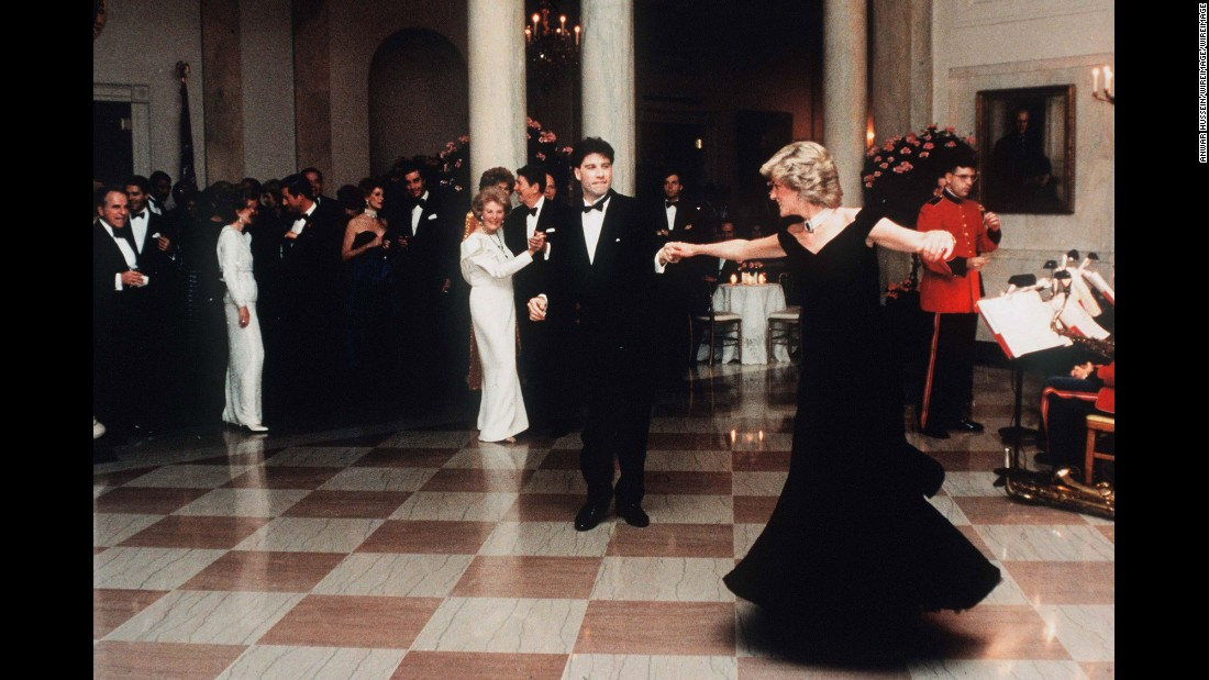 "Diana dances with actor John Travolta at the White House in November 1985. Dancing behind Travolta are US President Ronald Reagan and first lady Nancy Reagan. A few years ago, Diana's blue velvet dress -- nicknamed the ""Travolta dress"" -- was auctioned for 240,000 British pounds ($362,424 US)."