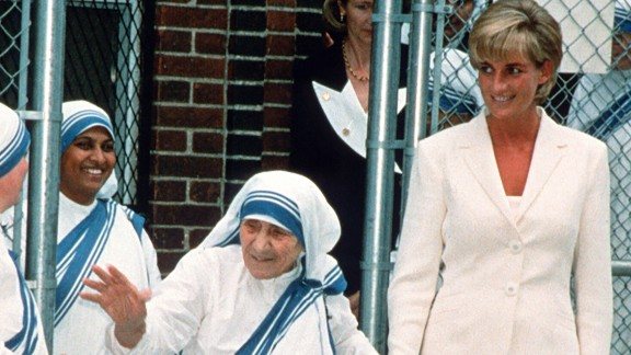 Diana holds hands with Mother Teresa after they met in New York in June 1997.