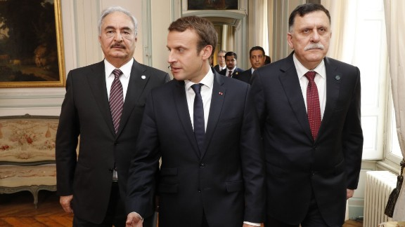 French President Emmanuel Macron is flanked Tuesday in Paris by Libyan Prime Minister Fayez al-Sarraj, left, and Gen. Khalifa Haftar.