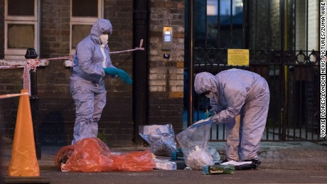 Forensic officers investigate a possible acid attack in east London Tuesday night.