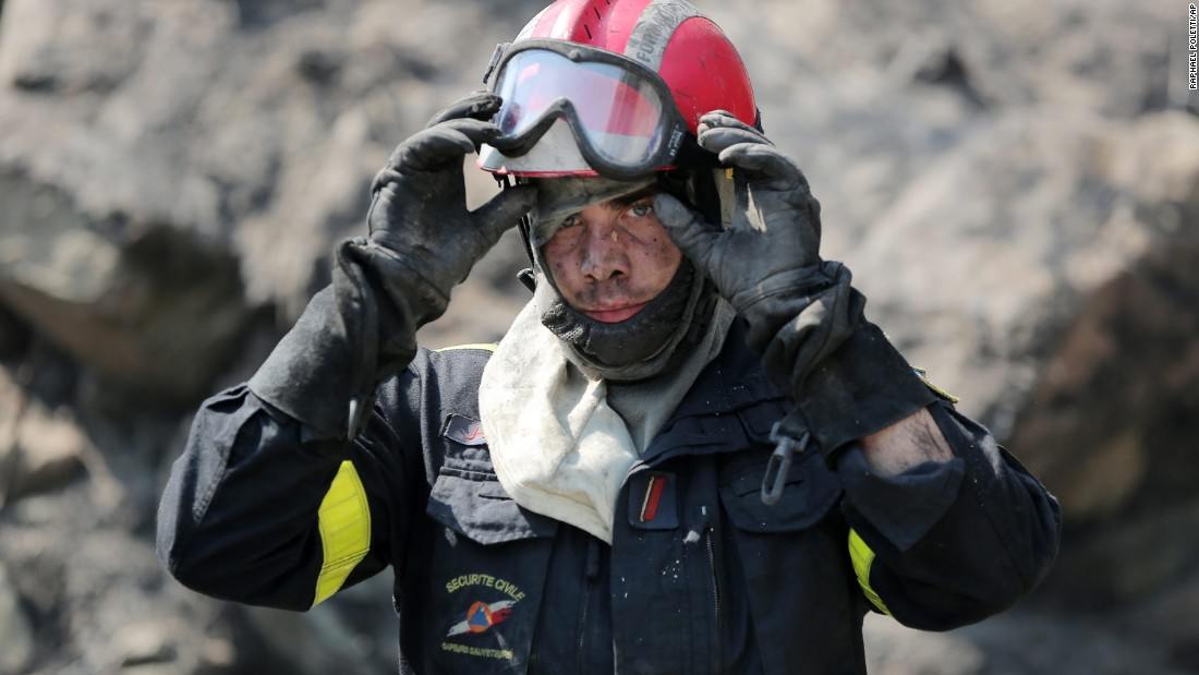 A firefighter takes a break at the site of a wildfire near Ortale, France, on July 25.