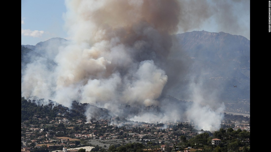 Smoke rises over the town of Carros, France, on Monday, July 24.
