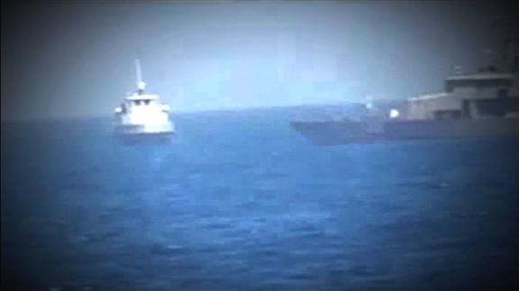us navy ship iranian boat