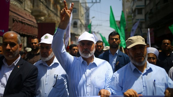 Hamas leader Ismail Haniya (C) attends a protest in Gaza City against new Israeli security measures.