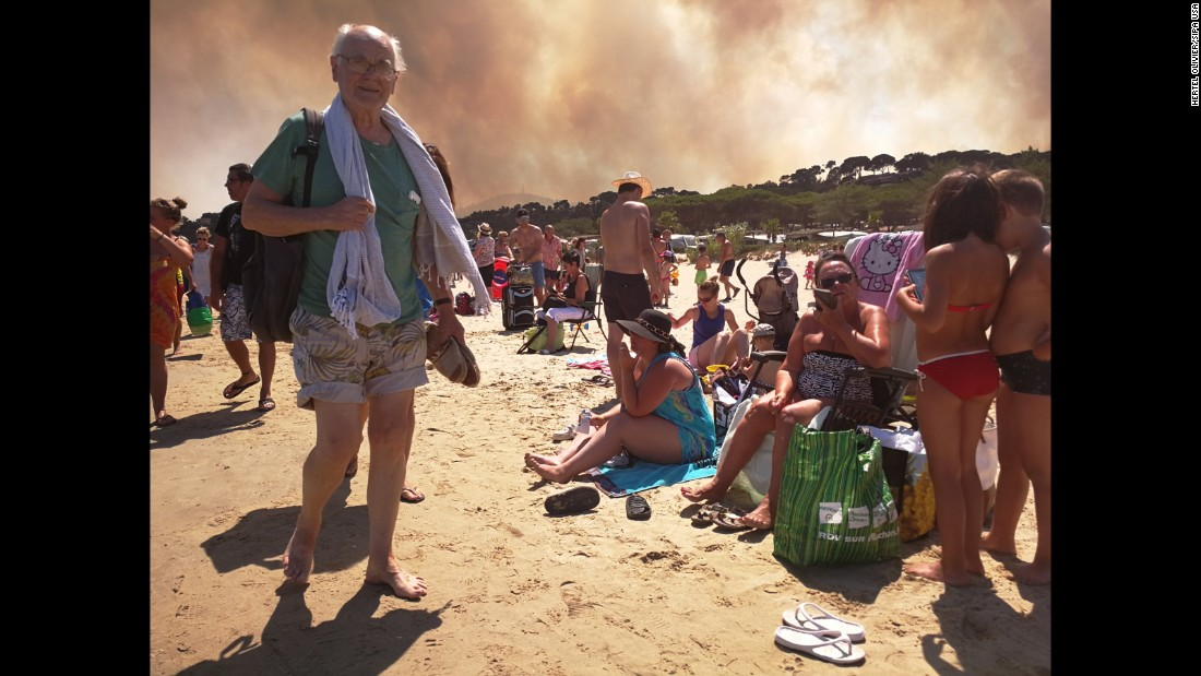"Tourists gather after a campsite was evacuated because of raging wildfires near Bormes-les-Mimosas, France, on Wednesday, July 26. Parts of the French Riviera <a href=""http://www.cnn.com/2017/07/26/europe/france-wildfire-evacuations/index.html"" target=""_blank"">were evacuated late Tuesday and into Wednesday </a>as forest fires burned swaths of land and threatened thousands of people."
