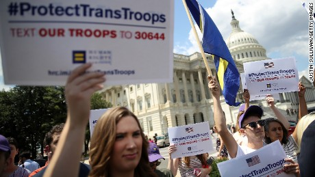 Gay rights supporters condemn a ban on transgender service members during a protest at the US Capitol on July 26, 2017 in Washington, DC.