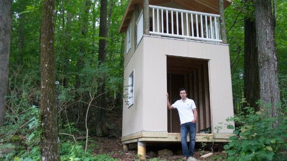 Joel Colindres stands next to the playhouse he is building for his children.