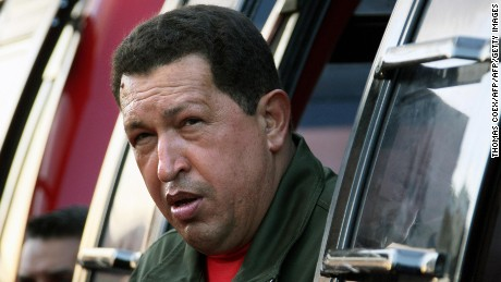 "Venezuela's President Hugo Chavez gestures during the inauguration of a cable metro (cable car) in Caracas on November 4, 2008. Chavez, an arch-critic of the United States, said an Obama victory would mean ""a small light on the horizon"". AFP PHOTO/Thomas Coex (Photo credit should read THOMAS COEX/AFP/Getty Images)"