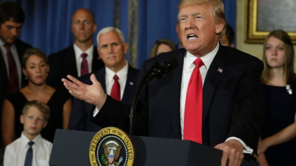 """US President Donald Trump delivers a statement on healthcare in front of alleged """"victims of Obamacare"""" at the White House in Washington on July 24, 2017. / AFP PHOTO / YURI GRIPAS        (Photo credit should read YURI GRIPAS/AFP/Getty Images)"""