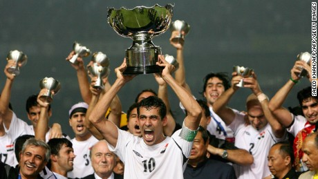 Iraq's captain Younis Mohmoud holds up the winning trophy as he along with teammates celebrate at the end of the final match of the Asian Football Cup 2007 at the Bung Karno stadium in Jakarta, 29 July 2007.