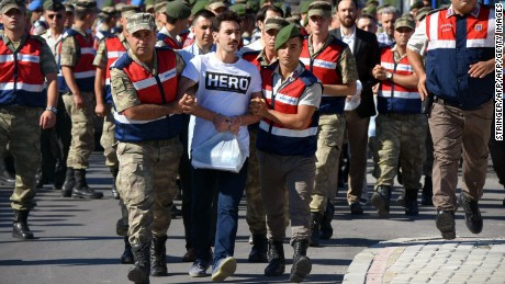 "Gokhan Guclu wore the ""HERO"" T-shirt to his court hearing on July 13."