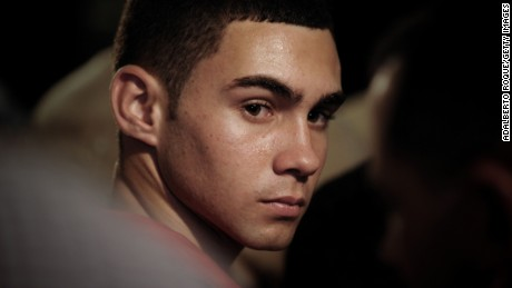 Cubanrafter-boy Elian Gonzalez (R), on June 30, 2010 is seen in a church of Havana, during the celebration of 10th Anniversary of his return from Miami.