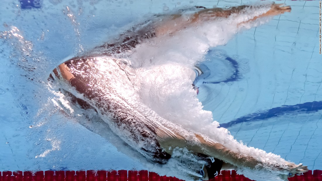 ... by viewing the competition from the perspective of an underwater camera the event has an altogether more surreal feeling. Here Dutch swimmer Ranomi Kromowidjojo is pictured competing in the women's 100 meter freestyle semifinal.