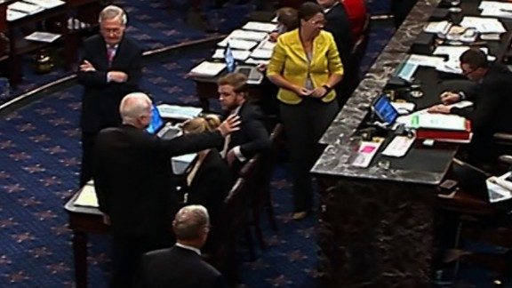 McCain gestures on the Senate floor.