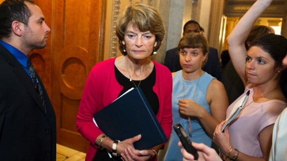 Sen. Lisa Murkowski, passes reporters as she leaves the Senate Chamber after voting