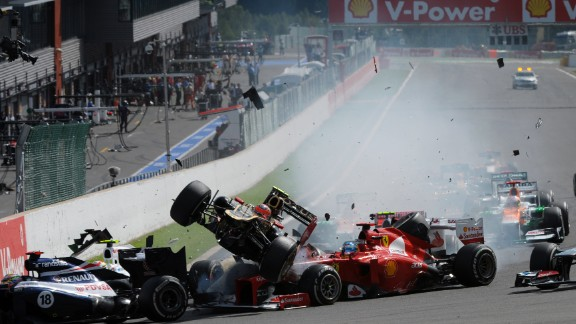Romain Grosjean's Lotus car narrowly avoids Fernando Alonso at the 2012 Belgium Grand Prix.