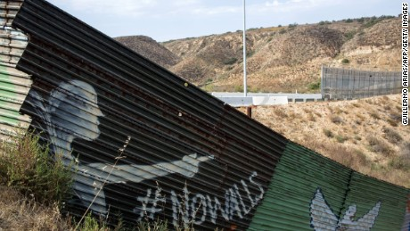 Partial view of the US-Mexico border wall painted by members of the Brotherhood Mural organization in Tijuana, Mexico on July 6, 2017.  US President Donald Trump said on July 7, 2017, he still wants Mexico to pay for a planned border wall, as he met his Mexican counterpart Enrique Pena Nieto on the sidelines of the G20 summit in Hamburg, Germany, for the first time as head of state. / AFP PHOTO / GUILLERMO ARIAS        (Photo credit should read GUILLERMO ARIAS/AFP/Getty Images)
