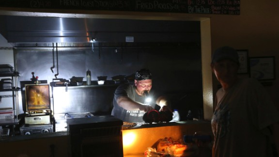 Aaron Howe cooks in a dark kitchen Friday on Hatteras Island.