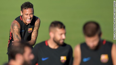 TOPSHOT - Barcelona's Brazilian forward Neymar takes part in a training session at Barry University in Miami, Florida, on July 27, 2017, two days before their International Champions Cup friendly match against Real Madrid. / AFP PHOTO / HECTOR RETAMAL        (Photo credit should read HECTOR RETAMAL/AFP/Getty Images)