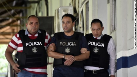 Roberto Borge (C), the former governor of the state of Quintana Roo, the sixth Mexican ex-governor under arrest for corruption, fraud, money laundering or involvement in organized crime, is escorted by Panamanian police in Panama City on June 5, 2017. Mexico sought Monday to extradite Borge, wanted on corruption charges, after he was arrested in Panama trying to board a flight to Paris. / AFP PHOTO / RODRIGO ARANGUA        (Photo credit should read RODRIGO ARANGUA/AFP/Getty Images)