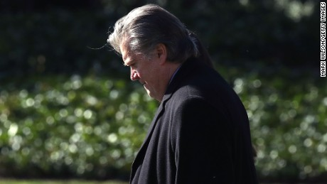 Chief strategist Steve Bannon walks behind President Donald Trump toward Marine One before departing from the White House on February 24, 2017 in Washington, DC.
