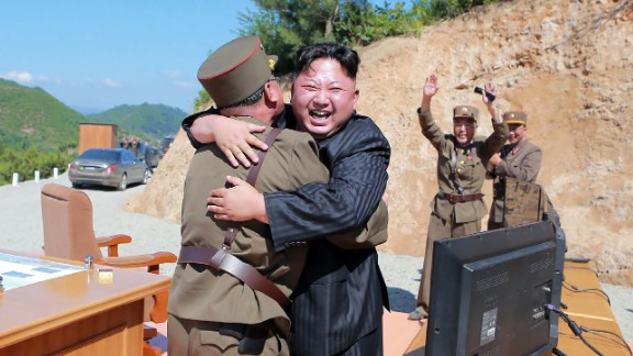 North Korean leader Kim Jong-Un celebrates the successful  of the intercontinental ballistic missile Hwasong-14 at an undisclosed location in July.